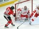 Jan 14, 2018; Chicago, IL, USA; Detroit Red Wings goalie Petr Mrazek (34) makes a save on a shot from Chicago Blackhawks right wing Ryan Hartman (38) during the third period at the United Center. Detroit won 4-0. Mandatory Credit: Dennis Wierzbicki-USA TODAY Sports