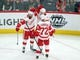 Jan 14, 2018; Chicago, IL, USA; Detroit Red Wings right wing Anthony Mantha (39) is congratulated for scoring by left wing Henrik Zetterberg (40) and center Andreas Athanasiou (72) during the third period against the Chicago Blackhawks at the United Center. Detroit won 4-0. Mandatory Credit: Dennis Wierzbicki-USA TODAY Sports