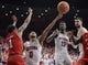 Jan 27, 2018; Tucson, AZ, USA; Arizona Wildcats guard Parker Jackson-Cartwright (0) shoots the ball as Utah Utes guard Justin Bibbins (1) defends during the second half at McKale Center. Mandatory Credit: Casey Sapio-USA TODAY Sports