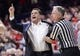 Jan 27, 2018; Tucson, AZ, USA; Arizona Wildcats head coach Sean Miller is held back by official Dick Cartmell during the first half against the Utah Utes at McKale Center. Mandatory Credit: Casey Sapio-USA TODAY Sports