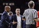 Jan 27, 2018; Tucson, AZ, USA; Arizona Wildcats associate head coach Lorenzo Romar (right) and head coach Sean Miller argues a call with official Dick Cartmell during the second half against the Utah Utes at McKale Center. Mandatory Credit: Casey Sapio-USA TODAY Sports