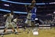 Feb 10, 2018; Washington, DC, USA;  Seton Hall Pirates guard Khadeen Carrington (0) shoots as Georgetown Hoyas guard Jonathan Mulmore (2) and center Jessie Govan (15) defends during the first half at Capital One Arena. Mandatory Credit: Tommy Gilligan-USA TODAY Sports