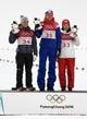 Feb 12, 2018; Pyeongchang, South Korea; Katharina Althaus (GER), Maren Lundby (NOR) and Sara Takanashi (JPN) celebrate on the podium after in the women's normal hill during the Pyeongchang 2018 Olympic Winter Games at Alpensia Ski Jumping Centre. Mandatory Credit: James Lang-USA TODAY Sports