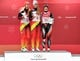Feb 13, 2018; Pyeongchang, South Korea; Silver medalist Dajana Eitberger (GER), left, gold medalist Natalie Geisenberger (GER) and bronze medalist Alex Gough (CAN) take the stand after competing in the luge single event during the Pyeongchang 2018 Olympic Winter Games at Olympic Sliding Centre. Mandatory Credit: Michael Madrid-USA TODAY Sports