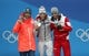 Feb 15, 2018; Pyeongchang, South Korea; Gold medalist Eric Frenzel (GER) , silver medalist Akito Watabe (JPN) and bronze medalist Lukas Klapfer (AUT) celebrate during the medals ceremony for the nordic combined individual normal hill/10km cross country event in the Pyeongchang 2018 Olympic Winter Games at Medals Plaza. Mandatory Credit: Geoff Burke-USA TODAY Sports