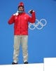 Feb 16, 2018; Pyeongchang, South Korea; Beat Feuz (SUI) celebrates winning the silver medal in the Super-G event during the medals ceremony in the Pyeongchang 2018 Olympic Winter Games at Medals Plaza. Mandatory Credit: Dan Powers-USA TODAY Sports