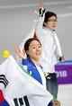 Feb 18, 2018; Pyeongchang, South Korea; Sang-Hwa Lee (KOR) and Nao Kodaira (JPN) celebrate after the women   s speed skating 500m during the Pyeongchang 2018 Olympic Winter Games at Gangneung Ice Arena. Mandatory Credit: Dan Powers-USA TODAY Sports