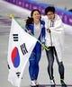 Feb 18, 2018; Pyeongchang, South Korea; Sang-Hwa Lee (KOR) celebrates winning silver and Nao Kodaira (JPN) celebrates winning gold in the women   s speed skating 500m during the Pyeongchang 2018 Olympic Winter Games at Gangneung Ice Arena. Mandatory Credit: Mark Hoffman-USA TODAY Sports