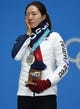 Feb 20, 2018; Pyeongchang, South Korea; Sang-Hwa Lee (KOR) cries as she celebrates winning the silver medal in the speed skating 500m event during the medals ceremony in the Pyeongchang 2018 Olympic Winter Games at Medals Plaza. Mandatory Credit: Kelvin Kuo-USA TODAY Sports