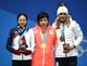 Feb 20, 2018; Pyeongchang, South Korea; Silver medal winner Sang-Hwa Lee (KOR), left, gold medal winner Nao Kodaira (JPN) and bronze medal winner Karolina Erbanova (CZE) celebrate their victories in the speed skating 500m event during the medals ceremony in the Pyeongchang 2018 Olympic Winter Games at Medals Plaza. Mandatory Credit: Kelvin Kuo-USA TODAY Sports