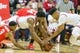 Feb 23, 2018; Bloomington, IN, USA; Indiana Hoosiers forward Freddie McSwain Jr. (21) and forward Juwan Morgan (13) and Ohio State Buckeyes forward Kaleb Wesson (34) dive for a loose ball in the first half at Assembly Hall. Mandatory Credit: Trevor Ruszkowski-USA TODAY Sports
