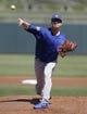 Mar 14, 2018; Surprise, AZ, USA; Chicago Cubs starting pitcher Alec Mills (24) throws against the Kansas City Royals at Surprise Stadium. Mandatory Credit: Rick Scuteri-USA TODAY Sports
