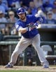 Mar 14, 2018; Surprise, AZ, USA; Chicago Cubs catcher Chris Gimenez (53) hits a sacrifice RBI bunt against the Kansas City Royals in the fifth inning against the Kansas City Royals at Surprise Stadium. Mandatory Credit: Rick Scuteri-USA TODAY Sports