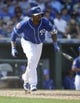 Mar 14, 2018; Surprise, AZ, USA; Kansas City Royals shortstop Alcides Escobar (2) hits a double in the fifth inning against the Chicago Cubs at Surprise Stadium. Mandatory Credit: Rick Scuteri-USA TODAY Sports