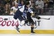 May 16, 2018; Las Vegas, NV, USA; Winnipeg Jets left wing Brandon Tanev (13) and Vegas Golden Knights defenseman Colin Miller (6) battle for the puck during the first period in game three of the Western Conference Final of the 2018 Stanley Cup Playoffs at T-Mobile Arena. Mandatory Credit: Kirby Lee-USA TODAY Sports
