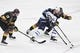 May 16, 2018; Las Vegas, NV, USA; Winnipeg Jets left wing Kyle Connor (81) attempts to move the puck between Vegas Golden Knights defenseman Nate Schmidt (88) and right wing Reilly Smith (19) during the second period in game three of the Western Conference Final of the 2018 Stanley Cup Playoffs at T-Mobile Arena. Mandatory Credit: Kirby Lee-USA TODAY Sports