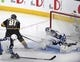 May 16, 2018; Las Vegas, NV, USA; Vegas Golden Knights center Jonathan Marchessault (81) scores a goal past Winnipeg Jets goalie Connor Hellebuyck (37) during the first period in game three of the Western Conference Final of the 2018 Stanley Cup Playoffs at T-Mobile Arena. Mandatory Credit: Stephen R. Sylvanie-USA TODAY Sports