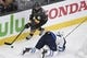 May 16, 2018; Las Vegas, NV, USA; Vegas Golden Knights left wing Pierre-Edouard Bellemare (41) moves the puck while Winnipeg Jets defenseman Tyler Myers (57) defends during the second period in game three of the Western Conference Final of the 2018 Stanley Cup Playoffs at T-Mobile Arena. Mandatory Credit: Kirby Lee-USA TODAY Sports