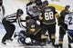May 16, 2018; Las Vegas, NV, USA; Vegas Golden Knights center Ryan Carpenter (40) and Winnipeg Jets center Mark Scheifele (55) tussle on the ice during the second period in game three of the Western Conference Final of the 2018 Stanley Cup Playoffs at T-Mobile Arena. Mandatory Credit: Kirby Lee-USA TODAY Sports