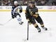 May 16, 2018; Las Vegas, NV, USA; Vegas Golden Knights left wing Erik Haula (56) moves the puck ahead ofWinnipeg Jets center Bryan Little (18) in game three of the Western Conference Final of the 2018 Stanley Cup Playoffs at T-Mobile Arena. Mandatory Credit: Stephen R. Sylvanie-USA TODAY Sports