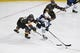 May 16, 2018; Las Vegas, NV, USA; Vegas Golden Knights left wing Tomas Nosek (92) and left wing Pierre-Edouard Bellemare (41) battle for the puck with Winnipeg Jets defenseman Ben Chiarot (7) in the second period of game three of the Western Conference Final of the 2018 Stanley Cup Playoffs at T-Mobile Arena. Mandatory Credit: Kirby Lee-USA TODAY Sports
