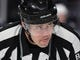 May 16, 2018; Las Vegas, NV, USA; NHL linesman Matt MacPherson checks the placement of players during a second period faceoff between the Winnipeg Jets and the Vegas Golden Knights in game three of the Western Conference Final of the 2018 Stanley Cup Playoffs at T-Mobile Arena. Mandatory Credit: Stephen R. Sylvanie-USA TODAY Sports