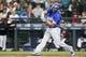 Jun 30, 2018; Seattle, WA, USA; Kansas City Royals third baseman Mike Moustakas (8) hits a three-run homer against the Seattle Mariners during the first inning at Safeco Field. Mandatory Credit: Joe Nicholson-USA TODAY Sports