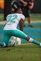 Aug 17, 2018; Charlotte, NC, USA; Miami Dolphins running back Kenyan Drake (32) stretches during warm ups at Bank of America Stadium against the Carolina Panthers. Mandatory Credit: Jim Dedmon-USA TODAY Sports