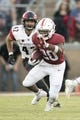 August 31, 2018; Stanford, CA, USA; Stanford Cardinal running back Bryce Love (20) runs in front of San Diego State Aztecs linebacker Troy Cassidy (42) during the second quarter at Stanford Stadium. Mandatory Credit: Kyle Terada-USA TODAY Sports