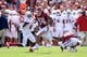 Sep 1, 2018; Norman, OK, USA; Oklahoma Sooners running back Rodney Anderson (24) runs by Florida Atlantic Owls safety James Pierre (23) during the first quarter at Gaylord Family - Oklahoma Memorial Stadium. Mandatory Credit: Mark D. Smith-USA TODAY Sports