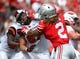 Sep 1, 2018; Columbus, OH, USA; Ohio State Buckeyes defensive end Chase Young (2) grapples with Oregon State Beavers offensive lineman Trent Moore (67) during the first quarter at Ohio Stadium. Mandatory Credit: Joe Maiorana-USA TODAY Sports