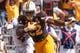 Sep 1, 2018; Laramie, WY, USA; Wyoming Cowboys running back Nico Evans (22) runs in for a touchdown against Washington State Cougars cornerback Marcus Strong (4) during the first quarter at Jonah Field War Memorial Stadium. Mandatory Credit: Troy Babbitt-USA TODAY Sports