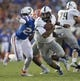 Sep 1, 2018; Gainesville, FL, USA; Charleston Southern Buccaneers quarterback London Johnson (1) tries to escape the rush of Florida Gators defensive back Chauncey Gardner-Johnson (23) during the first quarter at Ben Hill Griffin Stadium. Mandatory Credit: Glenn Beil-USA TODAY Sports