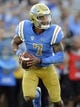 September 1, 2018; Pasadena, CA, USA; UCLA Bruins quarterback Dorian Thompson-Robinson (7) rolls out to pass against the Cincinnati Bearcats during the second half at the Rose Bowl. Mandatory Credit: Gary A. Vasquez-USA TODAY Sports