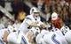 Sep 1, 2018; Tucson, AZ, USA; Brigham Young Cougars quarterback Tanner Mangum (12) signals during the first half against the Arizona Wildcats at Arizona Stadium. Mandatory Credit: Casey Sapio-USA TODAY Sports