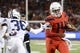 Sep 1, 2018; Tucson, AZ, USA; Arizona Wildcats quarterback Khalil Tate (14) runs the ball against Brigham Young Cougars defensive back D'Angelo Mandell (36) during the first half at Arizona Stadium. Mandatory Credit: Casey Sapio-USA TODAY Sports