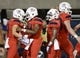 Sep 1, 2018; Tucson, AZ, USA; Arizona Wildcats wide receiver Tony Ellison (9) (left) celebrates with quarterback Khalil Tate (14) and wide receiver Shun Brown (6) after scoring a touchdown against the Brigham Young Cougars during the first half at Arizona Stadium. Mandatory Credit: Casey Sapio-USA TODAY Sports