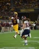 Sep 1, 2018; Tempe, AZ, USA; Arizona State Sun Devils quarterback Manny Wilkins (5) throws a touchdown pass against the UTSA Roadrunners during the first half at Sun Devil Stadium. Mandatory Credit: Joe Camporeale-USA TODAY Sports