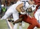 Sep 1, 2018; Tucson, AZ, USA; Brigham Young Cougars running back Lopini Katoa (4) is tackled by Arizona Wildcats cornerback Tim Hough (8) during the second half at Arizona Stadium. Mandatory Credit: Casey Sapio-USA TODAY Sports