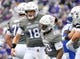 Sep 8, 2018; Evanston, IL, USA; Northwestern Wildcats quarterback Clayton Thorson (18) and Northwestern Wildcats running back Jeremy Larkin (28) celebrate in the first half after scoring against the Duke Blue Devils at Ryan Field. Mandatory Credit: Quinn Harris-USA TODAY Sports