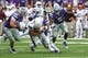 Sep 8, 2018; Manhattan, KS, USA; Kansas State Wildcats wide receiver Isaiah Zuber (7) is tackled by Kansas State Wildcats defensive back Eli Walker (7) and defensive end Wyatt Hubert (56) and linebacker Da'Quan Patton (5) during the fourth quarter at Bill Snyder Family Stadium. The Bulldogs won 31-10. Mandatory Credit: Scott Sewell-USA TODAY Sports