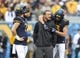 Sep 8, 2018; Morgantown, WV, USA; West Virginia Mountaineers quarterback Will Grier (7) and wide receiver David Sills V (13) talk with offensive coordinator Jake Spavital before a game against the Youngstown State Penguins at Mountaineer Field at Milan Puskar Stadium. Mandatory Credit: Ben Queen-USA TODAY Sports