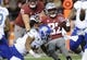 Sep 8, 2018; Pullman, WA, USA; Washington State Cougars running back James Williams (32) spends off the tackle of San Jose State Spartans safety Jalend Dinwiddie (34) during the first half at Martin Stadium. Mandatory Credit: James Snook-USA TODAY Sports