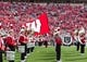 Sep 8, 2018; Madison, WI, USA; Wisconsin Badgers mascot Bucky Badger carries the Wisconsin flag through the marching band prior to the game against the New Mexico Lobos at Camp Randall Stadium. Mandatory Credit: Jeff Hanisch-USA TODAY Sports