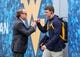 Sep 8, 2018; Morgantown, WV, USA; West Virginia Mountaineers head coach Dana Holgorsen greets West Virginia Mountaineers wide receiver David Sills V (13) as they arrive to the field prior to their game against the Youngstown State Penguins at Mountaineer Field at Milan Puskar Stadium. Mandatory Credit: Ben Queen-USA TODAY Sports