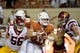 Sep 15, 2018; Austin, TX, USA; Texas Longhorns quarterback Sam Ehlinger (11) scrambles to avoid Southern California Trojans linebacker Jordan Iosefa (56) and Trojans linebacker Porter Gustin (45) during the first half at Darrell K Royal-Texas Memorial Stadium. Mandatory Credit: Kirby Lee-USA TODAY Sports