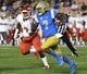 Sep 15, 2018; Pasadena, CA, USA; UCLA Bruins quarterback Dorian Thompson-Robinson (7) runs past Fresno State Bulldogs defensive back Chris Gaston (2) during the first quarter at the Rose Bowl. Mandatory Credit: Robert Hanashiro-USA TODAY Sports