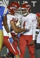 Sep 15, 2018; Pasadena, CA, USA; Fresno State Bulldogs quarterback Marcus McMaryion (6) celebrates with tight end David Tangipa (88) and offensive lineman Nick Abbs (77) after scoring a first quarter touchdown against the UCLA Bruins at Rose Bowl. Mandatory Credit: Robert Hanashiro-USA TODAY Sports
