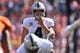 Sep 16, 2018; Denver, CO, USA; Oakland Raiders quarterback Derek Carr (4) at the line of scrimmage in the second quarter against the Denver Broncos at Broncos Stadium at Mile High. Mandatory Credit: Ron Chenoy-USA TODAY Sports