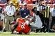 Sep 16, 2018; Denver, CO, USA; Denver Broncos nose tackle Domata Sr. Peko (94) tackles Oakland Raiders running back Doug Martin (28) in the first quarter at Broncos Stadium at Mile High. Mandatory Credit: Isaiah J. Downing-USA TODAY Sports